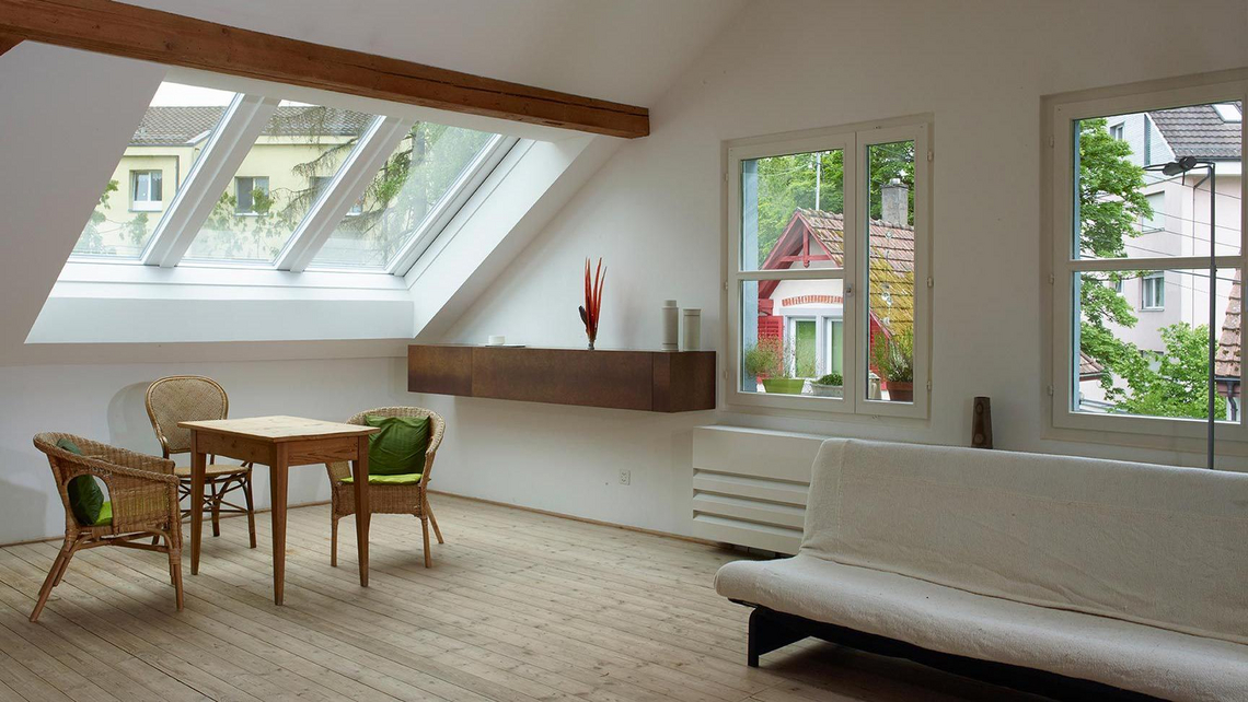 Attic apartment with a closed Azuro panorama roof window